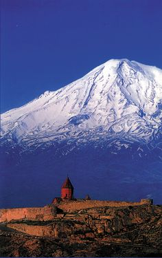 Mt Ararat, it's in the Bible, the Torah, and the Koran .... where Noah landed. It stands where Armenia, Iran, and Turkey come together. it's almost like they pushed it up. || .. X ღɱɧღ ||