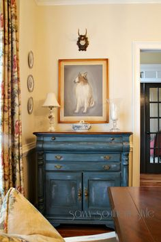 Prussian Blue buffet.  yellow walls.  Savvy Southern Style: Dining Room Chairs