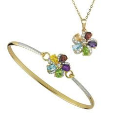 """Yellow Gold Plated Sterling Silver Multi-Gemstone Flower Bangle Bracelet and Pendant Necklace Set, 18"""" Amazon Curated Collection. $69.00. Bangle is 0.6 inches wide.. The natural properties and composition of mined gemstones define the unique beauty of each piece. The image may show slight differences to the actual stone in color and texture.. Made in China"""