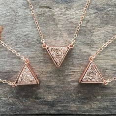 Super sparkly, rose gold druzy triangle takes center stage along a delicate cable chain. Natural druzy gemstone is vapor coated with titanium to bring out a brilliant, consistent rose gold color. It is housed in a bright rose gold plated frame, creating a beautiful contrast of tones and textures. Pendant measures approximately 1/2 tall x 1/2 wide. Chain is a delicate yet sturdy, 14K rose gold filled cable chain. It is finished with a curved lobster clasp closure for added security. ...