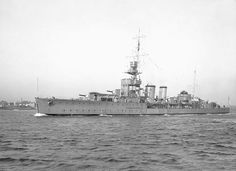 HMS Curacao, a Ceres series, C Class Light Cruiser. Built by Pembroke Dockyard & commissioned 18/02/18. Served as flagship of the 5th Light Cruiser Squadron at Harwich during WW I. Just before outbreak WW II entered dock for conversion t an AA Cruiser. 24/04/40 during Norway campaign suffered heavy damage from aerial bombing. On 02/10/42 whilst escorting RMS Queen Mary, due to a misunderstanding by both Captains she was rammed by Queen Mary and sank with only 99 survivors.