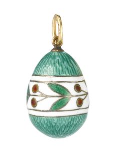 A FABERGÉ GOLD AND TRANSLUCENT ENAMEL PENDANT EGG, WORKMASTER FEDOR AFANASSIEV, ST. PETERSBURG, CIRCA 1890 enamelled translucent green over an engine-turned ground, the center with a chain of cherries and leaves against a white opaque ground, marked with workmaster's initials and 56 standard  Height 3/4 in.; 1.9 cm