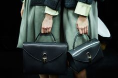 Vintage-style structured handbags in a deep teal shade at Giorgio Armani AW14 MFW. More images at: http://www.dazeddigital.com/fashionweek/womenswear/aw14