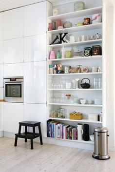 I really like this idea of open storage shelves in the kitchen for cookbooks, small appliances, etc.