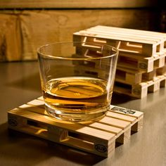 Show your pride in being a builder or warehouse worker by sitting your drinks down on these Palette-It Wooden Pallet Coasters By Design Studio Labyrinth.