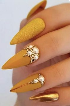 Best Yellow Nail Art Designs for Summer 2019 Fancy mustard yellow stiletto nails with glitter and rhinestones & an accent chrome nail! Gold Acrylic Nails, Silver Nails, Rhinestone Nails, Glitter Nails, Acrylic Nail Designs, Gel Nails, Black Nails, Nails News, Purple Nails