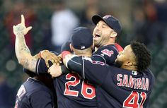 Cleveland Indians Joe Ramirez, Mike Napoli, Jason Kipnis and Carlos Santana celebrate after the Indians beat the Detroit Tigers  7-4 at Comerica Park in Detroit, Michigan on September 26, 2016.  (Chuck Crow/The Plain Dealer)