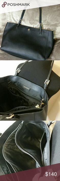 """Tory Burch Black York Buckle Tote Saffiano Leather Tory Burch Black York Buckle Tote  Flat leather straps 1 interior padded zip compartment in center perfect for 15"""" tablet, 2 open pockets, 1 hanging zip pocket, 2 inside drop in pockets Bag height: 11"""" Bag depth: 6"""" Bag length: 15"""" Condition: This tote is in good condition. It is a customer returnrd item. Good care should be taken with the thin straps as the Yorks are delicate in the strap area.  Great work tote with the middle padded…"""
