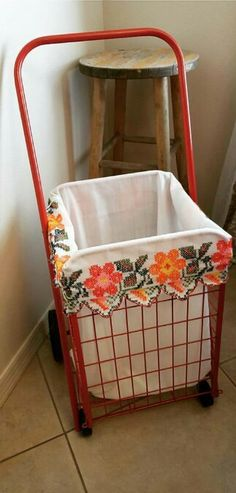 Turned an ugly old granny cart into a rolling hamper. Used an old grandma's night gown as liner. It had beautiful and colorful stitch work!!!