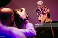 A model has her hair styled and make up applied backstage during the United Pro Future 2017 on March 18, 2017 in Bologna, Italy. United Pro Future 2017 is an Italian hair contest run by L'Oreal Professionnel for hairdressers under 30, and is being held as part of The 50th edition of Cosmoprof Worldwide Bologna.