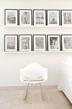 lovely wall shelves for black and white photos. Great way to decorate the wall.