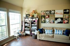 natural light studio    love canvas collage and prop storage. couch to nurse babies on!