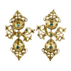 Circa 1780, these earrings are Spanish in origin.  Hand made in 18k gold and emeralds, most probably sourced in colonial mines in Columbia and Peru. Original ear wires and in Lazo earrings, the Spanish word for bow, they are a variation on the pendeloque drop. When worn in the Spanish court, they would have been accompanied by a large ribbon shaped bodice ornament.   The Iberian Peninsula produced outstanding jewels through the whole of the 18th century, but production came to an abrupt halt…