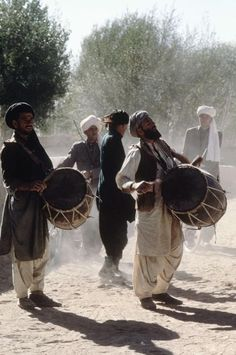Drummers and dancers on their way to a Kuchi wedding in Afghanistan. Kuchis are Afghan nomads similar to Arabian Bedouins, primarily from the Ghilji tribal confederacy.