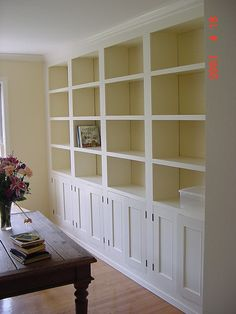Floor to ceiling built ins, with bookshelves and cabinets.