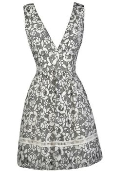 The beautiful floral pattern on this black and off white dress reminds us of sketchbook drawings. This is a feminine look for any party and can be worn in all 4 seasons, depending on how you accessorize. The Sketchbook Flowers Black and Off White A-Line Dress is fully lined. It is made of a sheer black mesh fabric with off white flowers on top. It has wide shoulder straps, a V neckline, and an empire waist. The attached skirt has a flowy A-line cut and is trimmed in crochet at the bottom. An…