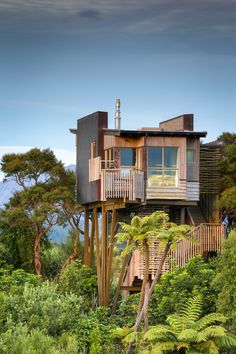 Hapuku Lodge Tree Houses, New Zealand | Nestled in the canopy of a 100-year-old Kanuka grove with views of Kaikoura mountains, these naturalistic tree houses draw inspiration from their magnificent surroundings. A façade embellished with native woods and copper shingles complements the interior furnishings, which were crafted by local woodworkers. From $563/night; hapukulodge.com