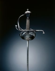 Rapier, c.1625-1650 Federico Picinino (Italian) steel; hilt russeted; wire grip, Overall - l:144.80 cm (l:57 inches) Wt: 1.38 kg Quillions - w:22.50 cm (w:8 13/16 inches).