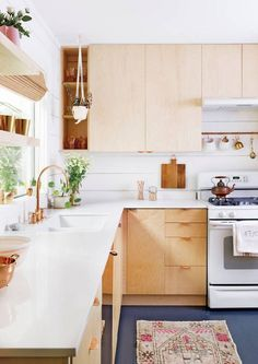 Discover the latest trends in kitchen design such as white birch cabinets, mixed patterns and materials, and so much more! For kitchen decorating ideas, tips, and inspiration, head to domino!