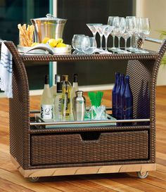 Our elegant, all-weather Ultimate Serving Cart makes entertaining outdoors easier. The handsomely woven cart preps and stores all the essentials for cocktail hour or afternoon brunch. You can stow plates, napkins, and silverware in the bottom drawer, and use the glass shelves to display glassware and other essentials.