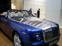 I would build an apartment over my very large garage for a personal driver to live, he would drive me around in something like this....Rolls-Royce Phantom Drophead Coupé