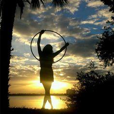 Learning how to hula hoop dance.