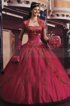 Dipped Neck Quinceanera Dress in Gorgeous Fuchsia with Vingtage Beaded Motif