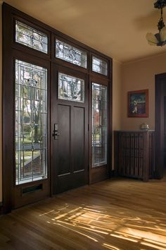 Craftsman Entryway with Transom window, Maple latte solid real hardwood flooring, Chandelier, Crown molding, Hardwood floors