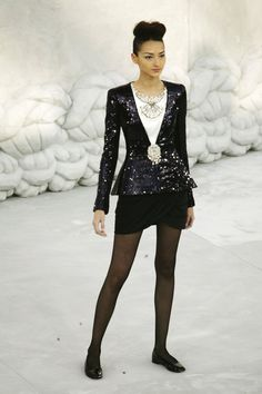 Pin for Later: So You Say You're a Chanel Fan? Haute Couture Spring 2008 Some of Spring 2008's Haute Couture pieces were surprisingly wearable, like this sequinned blazer with black shorts and sheer tights.