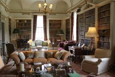 """Library at Holkham Hall. Holkham Hall was owned bei Thomas Cook during the Regency. When travelling the continent as a young man and staying at the European courts, he was known as """"Le Bel Anglais"""". Once, he accompanied the bride of Charles Edward Stuart to Rome. The young lady fell in love – not with her husband-to-be, but with Thomas Coke. See also http://regency-explorer.net/writers-travel-guide-holkham-hall/#more-397"""