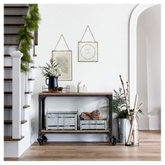 Mixing textures adds a level of interest and elegance to any space especially during the holidays. Wood trays, galvanized metal storage bins and faux greenery will make your foyer festive and functional at a friendly price.
