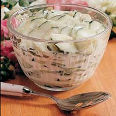 "Creamy Cucumbers Salad - ""It wouldnt be summer if Mom didnt make lots of these creamy cucumbers. Just a few simple ingredients—mayonnaise, sugar, vinegar and salt—dress up slices of this crisp garden vegetable."" —Michelle Bera"