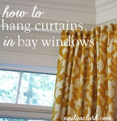 Hanging Curtains on Angled Windows - Emily A. Bay Window Treatments, Window Coverings, Bay Window Curtain Rod, Window Sheers, Curtain Call, Hanging Curtains, Window Hanging, Corner Curtains, How To Make Curtains