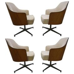 Four Milo Baughman Style Teak Back Swivel Dining Chairs, Mid-Century Modern | From a unique collection of antique and modern dining room chairs at https://www.1stdibs.com/furniture/seating/dining-room-chairs/