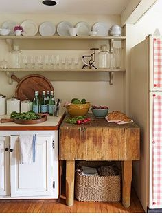 Love this budget decorating idea—A gingham paper tablecloth from West Elm, affixed with magnets, peps up a plain fridge (pictured on the right). #kitchens