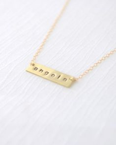The perfect personalized gift for bridesmaids, mom or yourself! Gold filled necklace holds a handmade brass bar with the lowercase letters of your choice. $55 CLICK HERE to buy https://www.oliveyew.com/product/name-necklace-bar-necklace-gold-bar-necklace/ #OliveYewJewelry