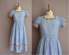 Lovely vintage 1940s cotton dress with a colorful blue and white print throughout, darling floral and house print trimming, square neckline