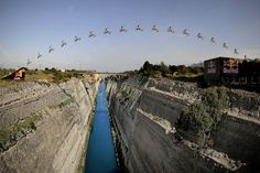 Robbie Maddison makes history as he completes an immense FMX jump over Greece's Corinth Canal.