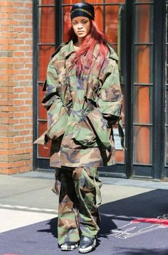 Rihanna Photos Pop Singer Rocks An Army Inspired Ensemble While Leaving Her Hotel In New York City On May Is Curly Nyc