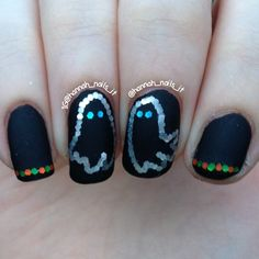 Pin for Later: 102 Halloween Nail Art Ideas That Are Better Than Your Costume Ghoulish Matte Glitter