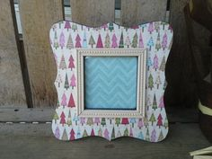 Check out this item in my Etsy shop https://www.etsy.com/listing/205120329/colorful-christmas-trees-frame-35x35