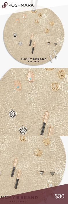 """Lucky Brand Leather Stud Set """"Featuring geometric symbols and peace signs, this eclectic collection of gold, silver and rose gold earrings come with seven sets of studs displayed on a leather patch that encourage mixing and matching.""""  Tri-tone plated metal Post closure  NEW with tags. Lucky Brand Jewelry Earrings"""