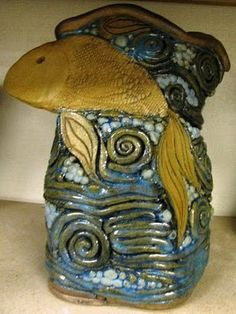 awesome coil vase.  Wish I was this creative when I took the pottery class