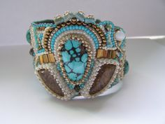 Embroidered cuff with turquise and bronzite gem stones ooak (135.00 USD) by DKHM
