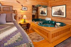 "Blueberry Hill - 1 Bedroom Gatlinburg Cabin Rental - Upon entering this adorable authentic log cabin named ""Blueberry Hill"", you are greeted with a spacious great room with gleaming wood floors. Get cozy in the king size bed or the hearth shaped jacuzzi in the same room! #under100 #cabin #amazingviews"