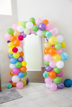 Colorful Balloon Arch at a Confetti-Themed Birthday Party - cute idea!