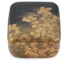 A Fine Lacquer Suzuribako [Writing Box]   Edo Period (18th-19th century)   With overhanging cover decorated in hiramaki-e, takamaki-e, nashji, fundame and kirigane on a black lacquer ground with chrysanthemums, grasses and flowers among rocks, fitted inner tray, silver waterdropper in the form of a butterfly  25cm. long
