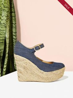 "USE CODE LABORYAY20 AT CHECKOUT. These canvas and hemp wedges are begging to be packed for your summer getaway to the south of France. Picture these ladies against the natural beauty of Provence as you and your beau explore the city. Bonnes vacances! Heel Height: 5"" Materials: Denim, Hemp"