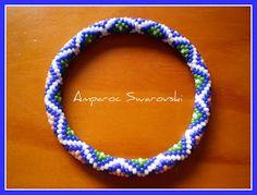 Artesanías Amparoc   6 around (see blue, red, white & yellow diamond pattern)
