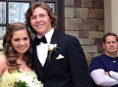 Gene Chizik gives the ultimate disapproving dad face to his daughter's prom date
